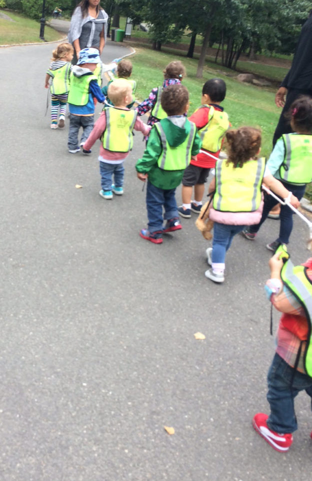 Pre-schoolers walking together attached by rope